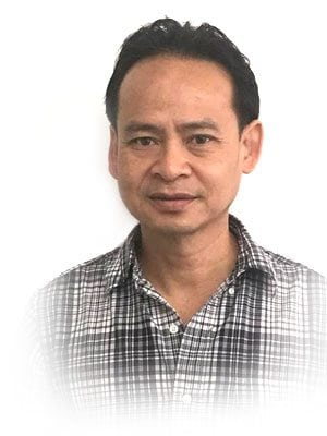 A closeup picture of Dr Anh Huynh of coorparoo denture clinic