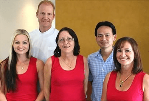 The coorparoo denture clinic team posing for a picture